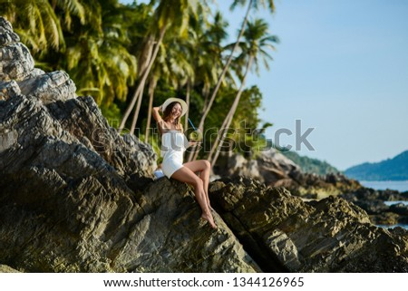 Beautiful girl on the beach with coconut in Thailand #1344126965