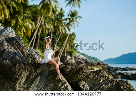 Beautiful girl on the beach with coconut in Thailand #1344126977