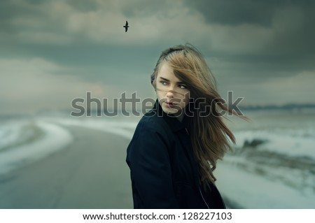 beautiful girl on the road in cold windy weather. Photo Gothic - stock photo
