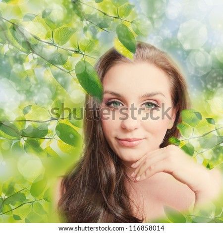 Beautiful Girl outdoors applying the natural cosmetics. Perfect fresh skin, natural beauty concept