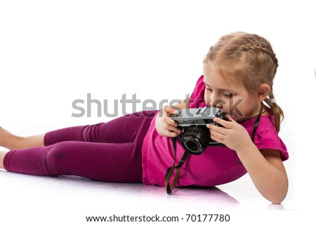 Beautiful girl  playing a photographer isolated on white