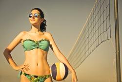 Beautiful girl playing beach volley