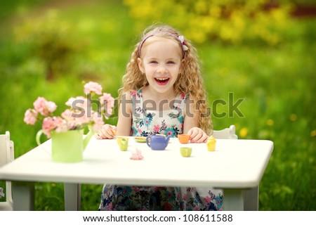 Beautiful girl playing in the spring garden