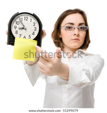 Beautiful girl points to clock with sticky (focus on clock)