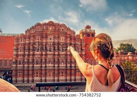 Beautiful girl points to Hawa Mahal. Wanderlust