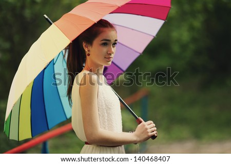 beautiful girl portrait with colorful umbrella