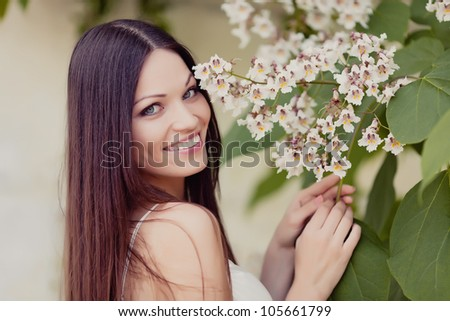 Beautiful girl portrait with flowers - stock photo