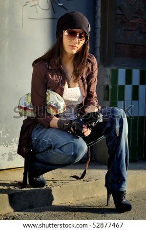Beautiful girl poses in the street