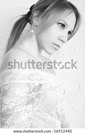Beautiful girl posing in studio. #56912440
