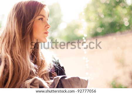 Beautiful girl posing outdoors in the summer