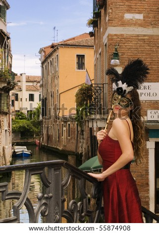 beautiful girl posing with mask in Venice