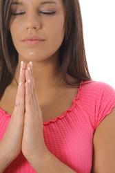 beautiful girl praying upclose