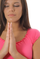 beautiful girl praying upclose vertical