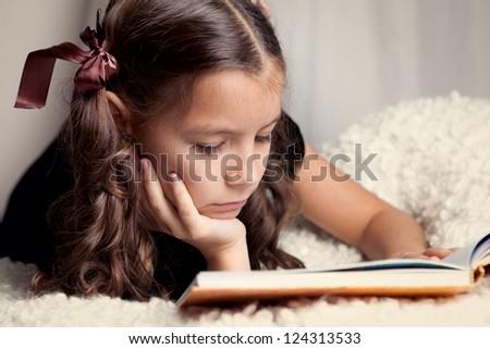 Beautiful girl reading  book