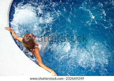 Beautiful girl relaxing in jacuzzi. Summer vacation Photo stock ©