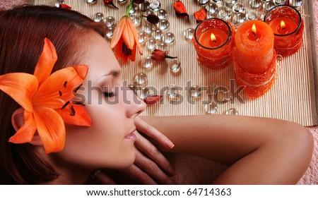 beautiful girl relaxing in spa salon