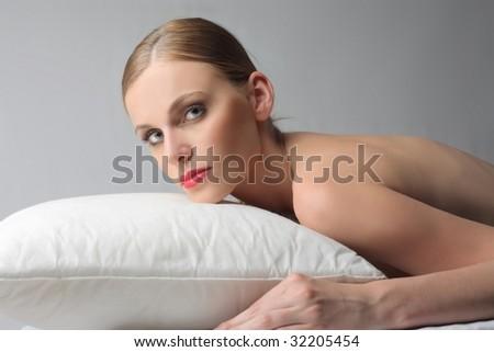 beautiful girl relaxing on a pillow