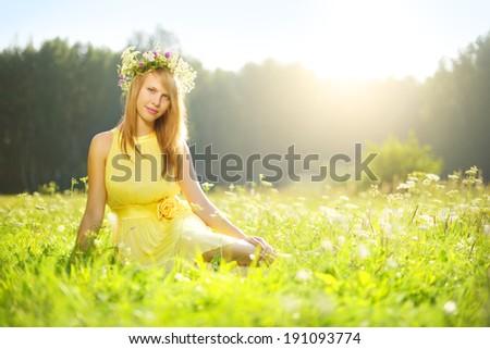 Beautiful girl relaxing outdoors. morning sun