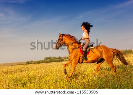 Beautiful girl riding a horse in countryside #115550506