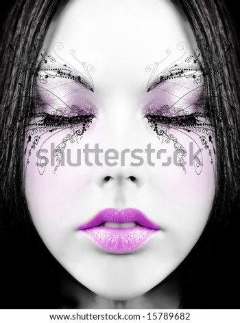 beautiful girl's face with creative painted makeup