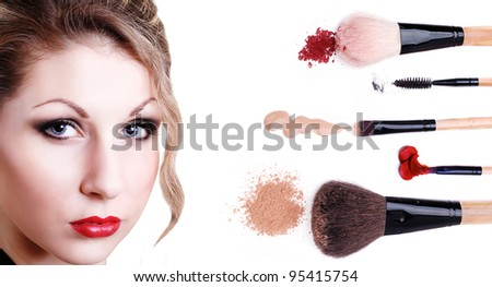 Beautiful girl's perfect makeup face  with cosmetic and makeup brushes