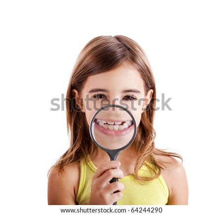 Beautiful girl showing teethes through a magnifying glass