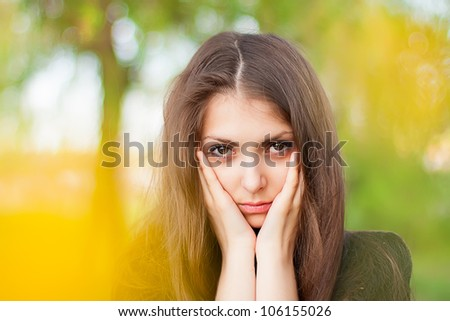 Beautiful girl shows an emotional sad face