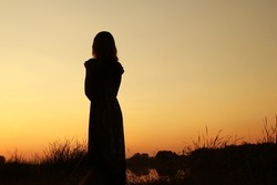 beautiful girl silhouette on nature in the park