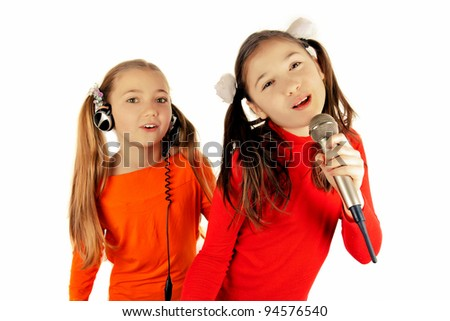 Beautiful girl singing into a microphone