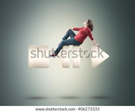 Beautiful girl sitting on music buttons .  - Shutterstock ID 406273333
