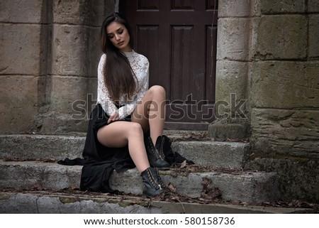 beautiful girl sitting on old...