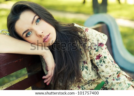 beautiful girl sitting on the bench resting