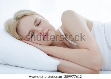 Beautiful girl sleeping in bed.