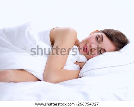 Beautiful girl sleeps in the bedroom, lying on bed.
