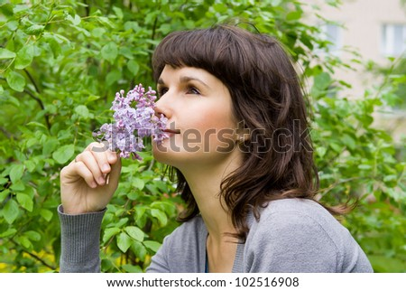 beautiful girl smell the lilacs, in nature