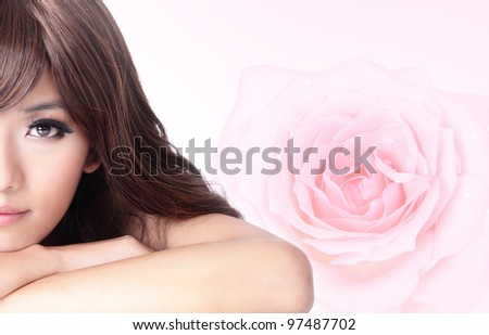 Beautiful Girl smile face close up with pink rose background, model is a asian beauty