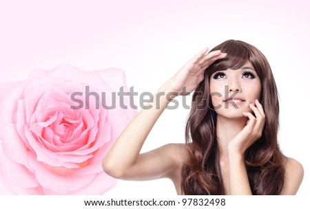 Beautiful Girl smile face close up with pink rose background,model look up forward, model is a asian beauty