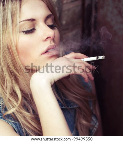 beautiful girl smokes while waiting