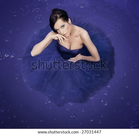 Beautiful girl standing in a big container - color version