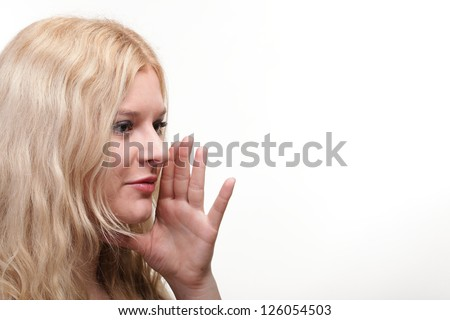 beautiful girl talking speaking out with hands around mouth white background