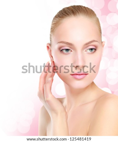 Beautiful Girl Touching Her Face