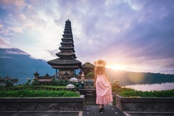 Beautiful girl visiting the ulun danu bratan temple in Bali. Concept about exotic lifestyle wanderlust traveling
