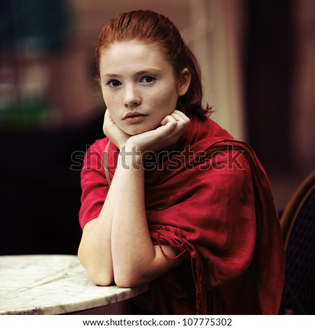 beautiful girl waiting at a table in a cafe