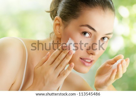 beautiful girl washes his face
