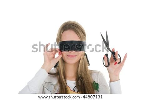Beautiful girl wearing black band on his eyes and holding scissors