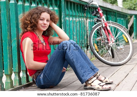 beautiful girl with a bicycle - stock photo