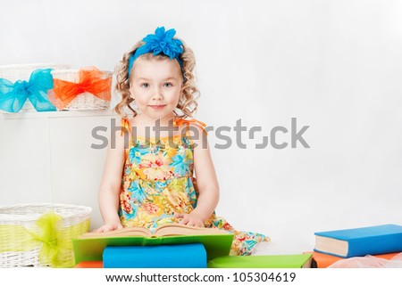 Beautiful girl with a book, on a gray background