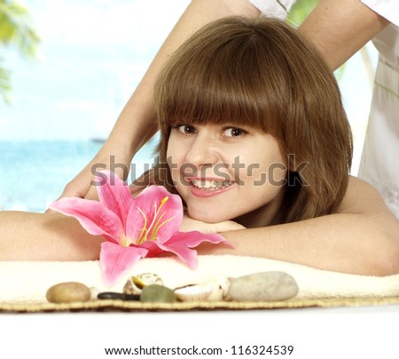 beautiful girl with a bright appearance rests in the spa