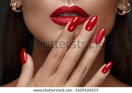 Beautiful girl with a classic make up and multi-colored nails. Manicure design. Beauty face. Photo taken in the studio Foto d'archivio ©