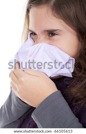 Beautiful girl with a cold blowing nose